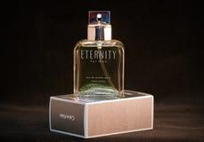 Calvin Klein Eternity. Eau de toilette for men bottle and pack against black background Royalty Free Stock Images