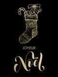 Calza del regalo di scintillio dell'oro di Joyeux Noel Merry Christmas del francese Immagini Stock