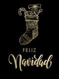 Calza di scintillio dell'oro di Feliz Navidad Spanish Merry Christmas Fotografia Stock
