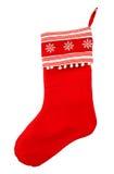 Calza rossa di natale per i regali di Santa su un fondo bianco Fotografia Stock Libera da Diritti