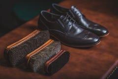 Calzado y equipo de cuero para limpiar Foto de archivo