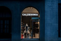 Calzedonia logo on a shop taken at night. Calzedonia is an Italian fashion brand specialized in women underwear. Picture of a Calzedonia shop in Downtown Stock Photo