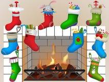 Calzini di Natale dal camino Immagini Stock
