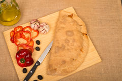 Calzone and ingredients Royalty Free Stock Images
