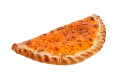 A calzone pie with a golden egg washed crust. Studio isolated Stock Image
