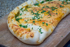 Calzone pizza. Home made calzone pizza with a parsley topping royalty free stock photography