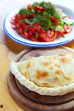 Calzone and salad Royalty Free Stock Photography