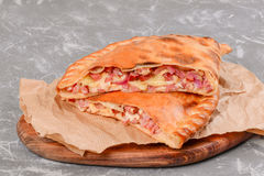 Calzone in the section is shot close-up stock photo