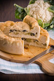 Calzone stuffed with olive and cauliflower. Stock Photos
