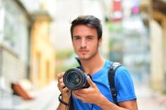 Caméra de photographe de Canon DSLR dans des mains photographie stock