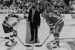 Cam Neely, Ray Bourque & Mark Messier. Cam Neely drops a ceremonial face-off puck to Bruins captain Ray Bourque and NY Rangers Captain Mark Messier. (Image taken stock image
