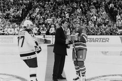 Cam Neely shakes hands with Mark Messier. Cam Neely shakes hands with NY Rangers Captain Mark Messier. (Image taken from B&W) negative stock image