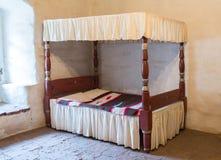 Cama antigua de la cama imperial Fotos de archivo libres de regalías