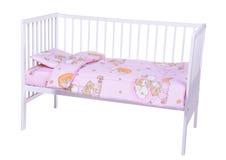 Cama de bebé en blanco Imagen de archivo libre de regalías