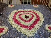 Cama del corazón de la flor foto de archivo