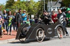 Cama do impulso de Team Dressed Like Batman Characters no evento do Fundraiser imagens de stock royalty free