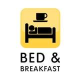 Cama - e - logotipo do ícone do pequeno almoço Fotos de Stock Royalty Free