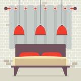 Cama matrimonial con las lámparas rojas del techo en Front Of Brick Wall Fotografía de archivo libre de regalías