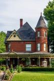 Cama victoriana del ladrillo - y - hogar del desayuno Fotografía de archivo