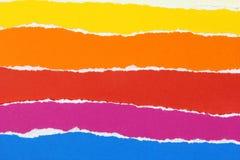 Camadas de papéis rasgados coloridos Foto de Stock