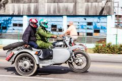 CAMAGUEY, CUBA - JAN 26, 2016: Motorcycle with a side car on a road in Camague. Y stock photo
