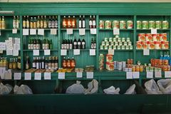 Shelves of a ration shop in Camaguey, Cuba. Camaguey, Cuba - March 7, 2018: Shelves of a ration shop with the goods exposed Royalty Free Stock Image