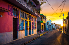 CAMAGUEY, CUBA - Street view of UNESCO heritage city centre. The warm sunset light shines on the empty streets of the world heritage city centre in the Cuban Stock Image