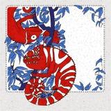 2 camaleones en abranch con los laeves azules imagenes de archivo