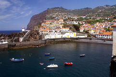 Camara de Lobos, Madeira. Fishing village Camara de Lobos on madeira. Cabo Girao, the second highest cliff in the world on the background Royalty Free Stock Images
