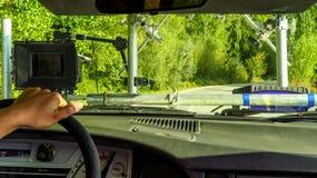 Camara fixed on the hood of a car Stock Image