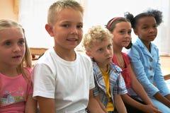 Camarades de classe à la leçon Image libre de droits
