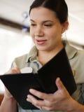 Camarera que toma una orden del alimento Imágenes de archivo libres de regalías