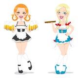 Camareras hermosas de Oktoberfest Imágenes de archivo libres de regalías