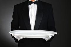 Camarero con la bandeja blanca grande Foto de archivo