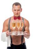 Camarero de sexo masculino con los vidrios del champán Imagenes de archivo