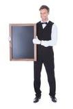 Camarero Holding Chalkboard Fotografía de archivo libre de regalías