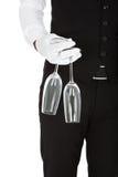 Camarero Holding Champagne Glasses Fotografía de archivo