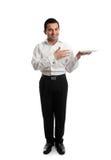 Camarero o criado que sostiene una placa blanca Imagen de archivo