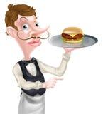 Camarero Pointing de la hamburguesa Fotos de archivo