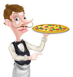 Camarero Pointing de la pizza Fotografía de archivo