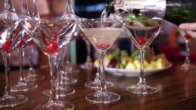 Camarero Pouring Champagne Into Glasses almacen de video