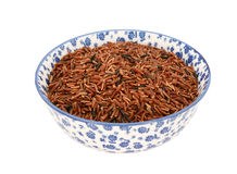 Camargue red rice in a blue and white china bowl Stock Photography