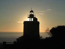 The Camarinal`s lighthouse at the sunset Stock Image