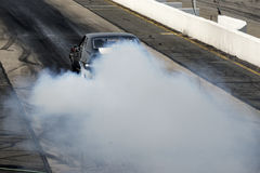 Camaro burnout on the track Stock Photography