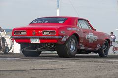 Camaro drag car. Napierville dragway july 12, 2014 picture of red chevrolet camaro in preparation on the track during nhra national open event Stock Photo