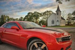 Camaro in front of old church stock photos