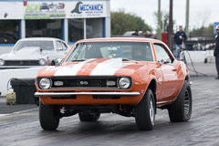 Camaro. Napierville, Canada - September 14: An unnamed driver accelerates his camaro drag car hard at Napierville dragway during the drag competition 2013 Stock Photography