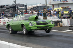 Drag racing. Napierville dragway july 12, 2014 front side view of chevrolet camaro drag car making a wheelie during nhra national open event Royalty Free Stock Photo