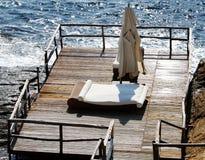 Camas de la terraza y de la playa Foto de archivo libre de regalías