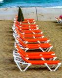Camas vacías en la playa Imágenes de archivo libres de regalías